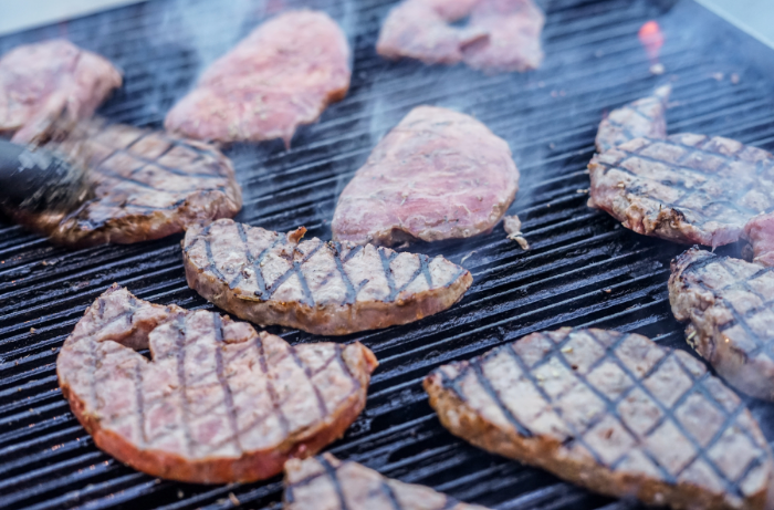 Steaks cooking on BBQ