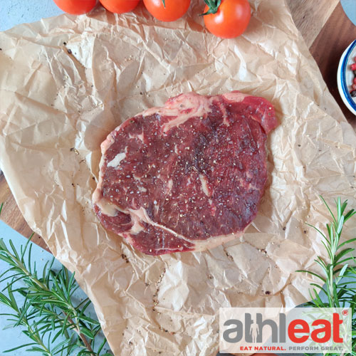 Grass Fed Beef Rib Eye Steak by Athleat on butchers paper