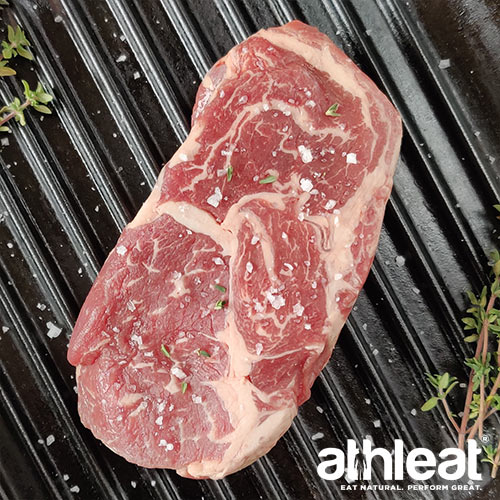 Grass Fed Ribeye beef steak in frying pan by Athleat