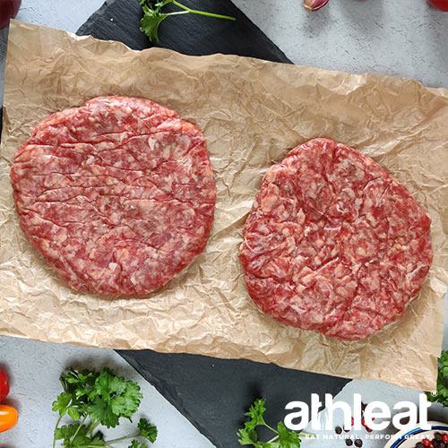Grass fed beef steak burgers on butchers paper by Athleat