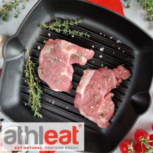 Grass fed lamb leg steaks in frying pan