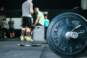 Barbell in gym in foreground